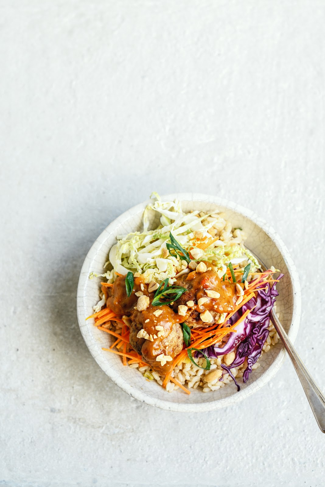 meatballs on brown rice with peanut sauce & Asian slaw – Stuck in ...